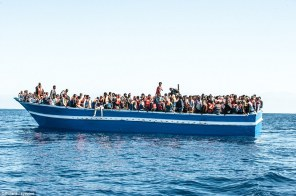 More than 1,000 migrants are packed onto a rickety wooden boat that was cut adrift in the Mediterranean as they desperately tried to flee Libya