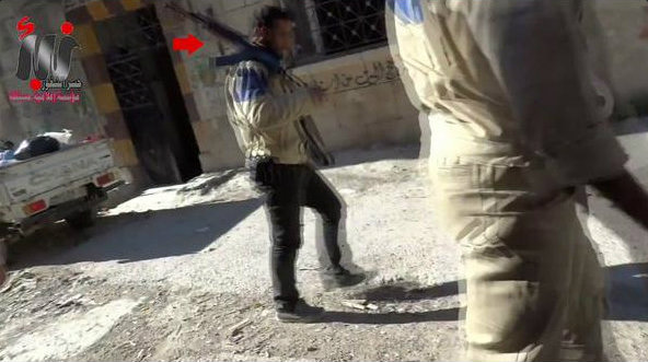 Screenshot from video clearly showing White Helmet members carrying guns.