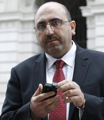 FIXER: Rami Abdul Rahman, head of the Syrian Observatory for Human Rights, leaves the Foreign and Commonwealth Office after meeting Britain's Foreign Secretary, William Hague, in central London November 21, 2011. Photo Source: REUTERS/Luke MacGregor.